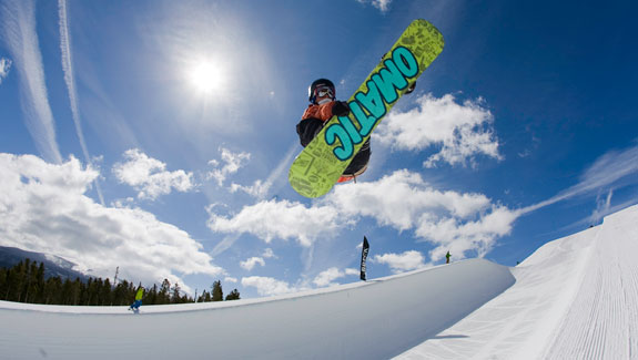 Snowboarder in halfpipe at Breck