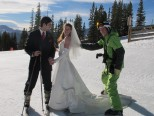 An EpicMix photographer helps a bride and groom