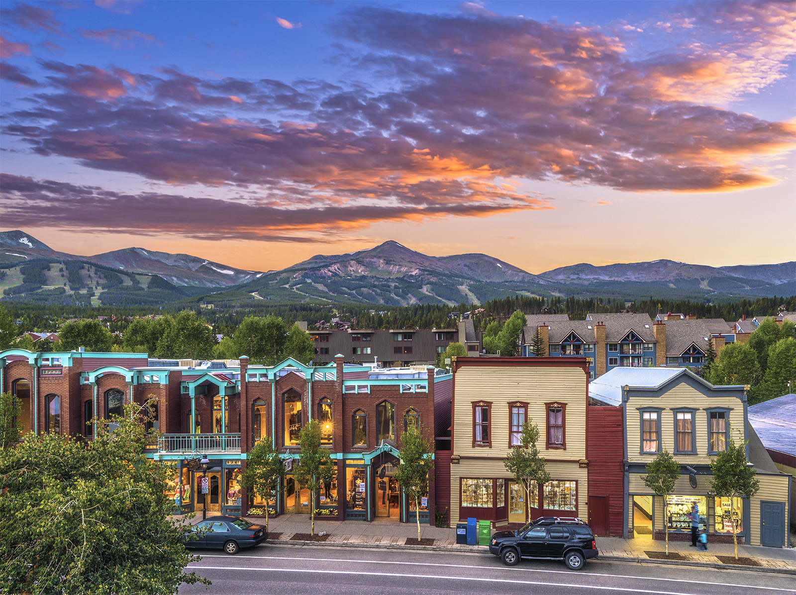 Main street of Breckenridge during sunset with the ski resort in the background